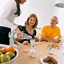 Family playing board game at kitchen table