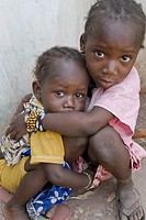 Two scared sisters looking to the camera, Senegal, Africa