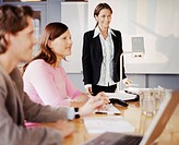 Businessman and pair of businesswomen in meeting