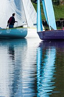 Small sailing boats on the Arrow valley lake country park, Redditch, Worcestershire, West Midlands, England, UK