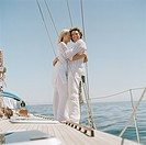 Young couple embracing on board of recreational yacht