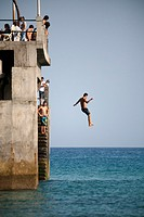 Man jumping from the dock, Porto Santo, Madeira