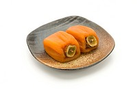 Dried persimmons on a plate