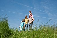 Family standing on a meadow