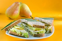 Sandwich with Bresse Bleu cheese, pear, salad, acacia honey and chives
