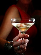 A woman holding a champagne glass in a bar