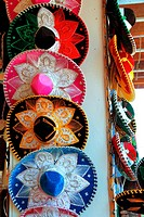 Charro Mexican mariachi colorful hats in row