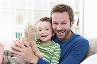 Germany, Bavaria, Munich, Father and son 2_3 Years with teddy bear, portrait, smiling