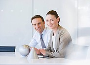 Business people in conference room with sphere and cone