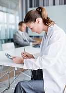 Scientist working in conference room