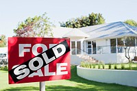 Sold sign in front yard of house (thumbnail)