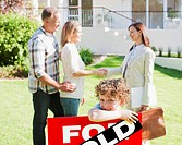 Realtor congratulating family on buying new house