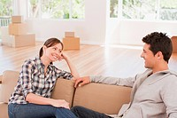 Couple relaxing on sofa in new house