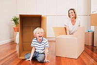Mother and son with boxes in new house