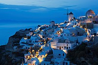 Greece, Cyclades, Thira, Santorini, View of Oia and windmills after sunset
