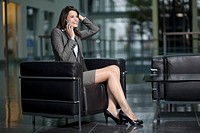 Germany, Bavaria, Business woman on the phone, smiling
