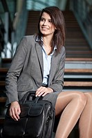 Germany, Bavaria, Business woman looking away, smiling