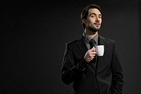 Young man with coffee cup, portrait