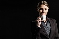 Young woman with coffee cup, portrait
