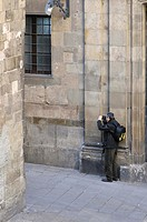 Man taking a photograph. Bisbe street. Ghotic quarter. Barcelona. Catalonia. Spain