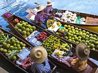 Fruit seller in the Damnoen Saduak floating market, 100 km away from Bangkok Thailand