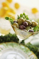 Various Olives in a Cocktail Glass