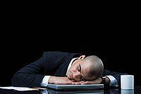 Businessman napping on a laptop
