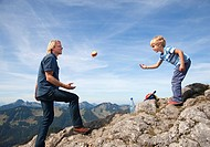 Germany, Bavaria, Father and son 4_5 Years playing on mountain summit