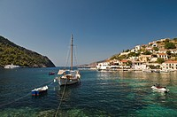Looking across the harbour at the the village of Assos in Northern Cephallonia, Greece