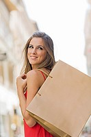 Portrait of a beautiful blonde woman shopping