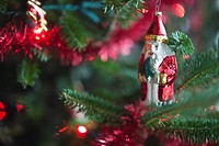 Santa Claus Christmas decoration hanging on Christmas tree, studio shot