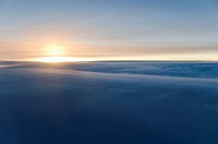 Sunrise over clouds
