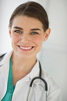 Portrait of cheerful female doctor