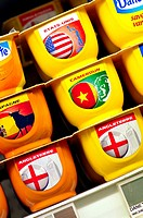 Yogurts with flags from different countries in a supermarket, France
