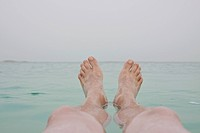 Israel, Dead Sea, mature men´s legs in sea