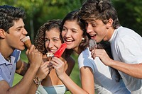 Hispanic friends eating ice cream together
