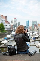 young photographer in the city harbor Düsseldorf