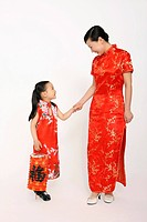 Woman and girl in cheongsam, girl holding chinese lantern