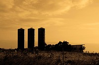 Silos in a field at dusk, Pakini Nui Wind Project, South Point, Big Island, Hawaii, USA