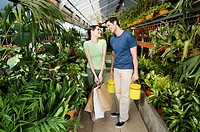 Couple shopping in a greenhouse
