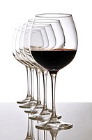 red wine glass and empty glasses
