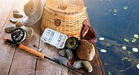 Close_up of fishing equipment and hat