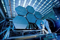 James Webb Space Telescope JWST mirror. Technicians testing six beryllium mirror segments for the JWST. This space telescope has 18 such segments, eac...