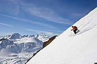 A young man skis down a steep slope at St. Anton am Arlberg, Austria.