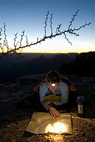 Woman reads map by headlamp.