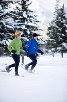 Couple snowshoeing in Canada.