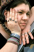 close up of teenage girl with studs,rings,spikey neckpiece looking rather bemused
