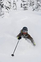Young woman skiing in deep powder.
