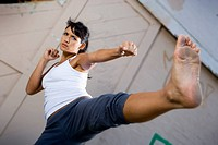 Woman kick boxer training.
