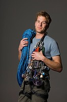 Portrait of rock climber with gear.